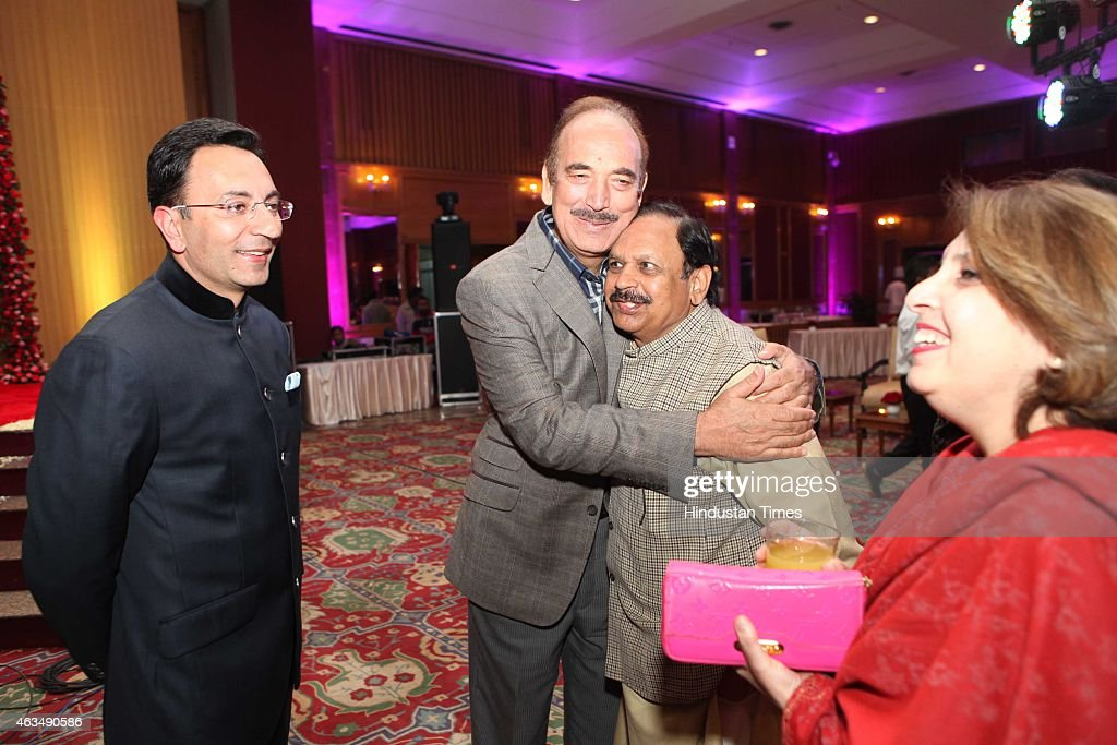 Indian politicians Jitin Prasada (L) and <a gi-track='captionPersonalityLinkClicked' href=/galleries/search?phrase=Ghulam+Nabi+Azad&family=editorial&specificpeople=772783 ng-click='$event.stopPropagation()'>Ghulam Nabi Azad</a> (2L) during the wedding reception of Member of Parliament T Subbarami Reddy's grandson Rajiv Reddy and Kavya at Ashoka Hotel on February 10, 2015 in New Delhi, India.