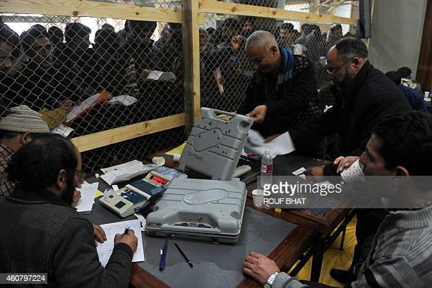 Indian polling officials count votes from an electronic voting machine at a counting centre in Srinagar on December 23 2014 Prime minister Narendra...