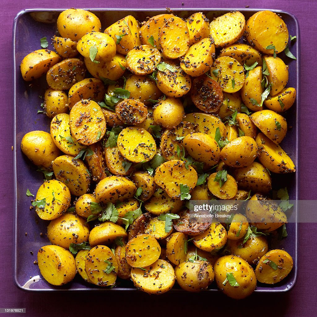 Indian Potatos with Black and Yellow Mustard Seeds : Stock Photo
