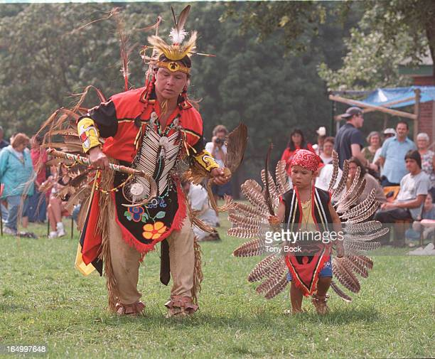 Indian Powwow at Dufferin Grove Park Rod Nettagog an Ojibwa from Henvey Inlet nr French River danced with his son Jarod 3 1/2
