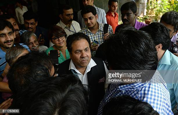 Indian Premier League chairman Rajeev Shukla is surrounded by journalists after attending a special meeting at the Board of Control for Cricket in...