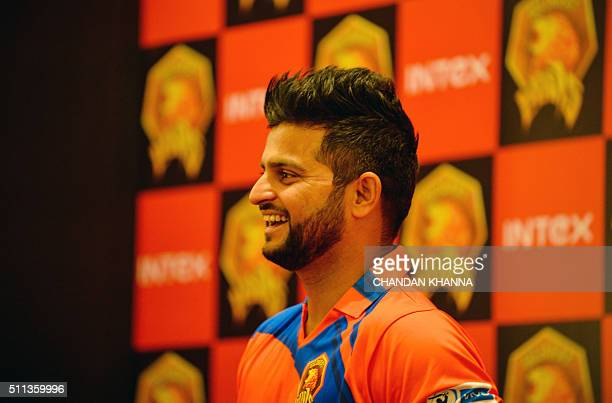 Indian Premier League Gujrat Lions cricket team captain Suresh Raina looks on during an event to unveil the team jersey in New Delhi on February 20...