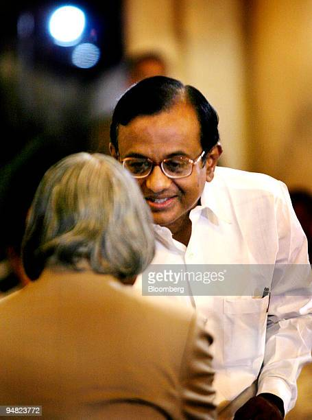 Indian President A P J Abdul Kalam left greets Finance Minister Palaniappan Chidambaram after administering the oath of office in New Delhi late...
