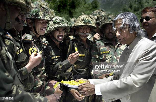 Indian President Abdul Kalam offers sweets to Indian soldiers during a visit in Uri 28 June 2003 near the Line of Control some 102 kms north of...