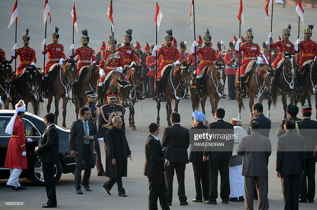 Indian President Pranab Mukherjee (C-L) arrives for the Beating Retreat Ceremony at Vijay Chowk in New Delhi on January 29, 2013. The ceremony is a culmination of Republic Day celebrations and dates back to the days when troops disengaged themselves from battle at sunset. AFP PHOTO/RAVEENDRAN
