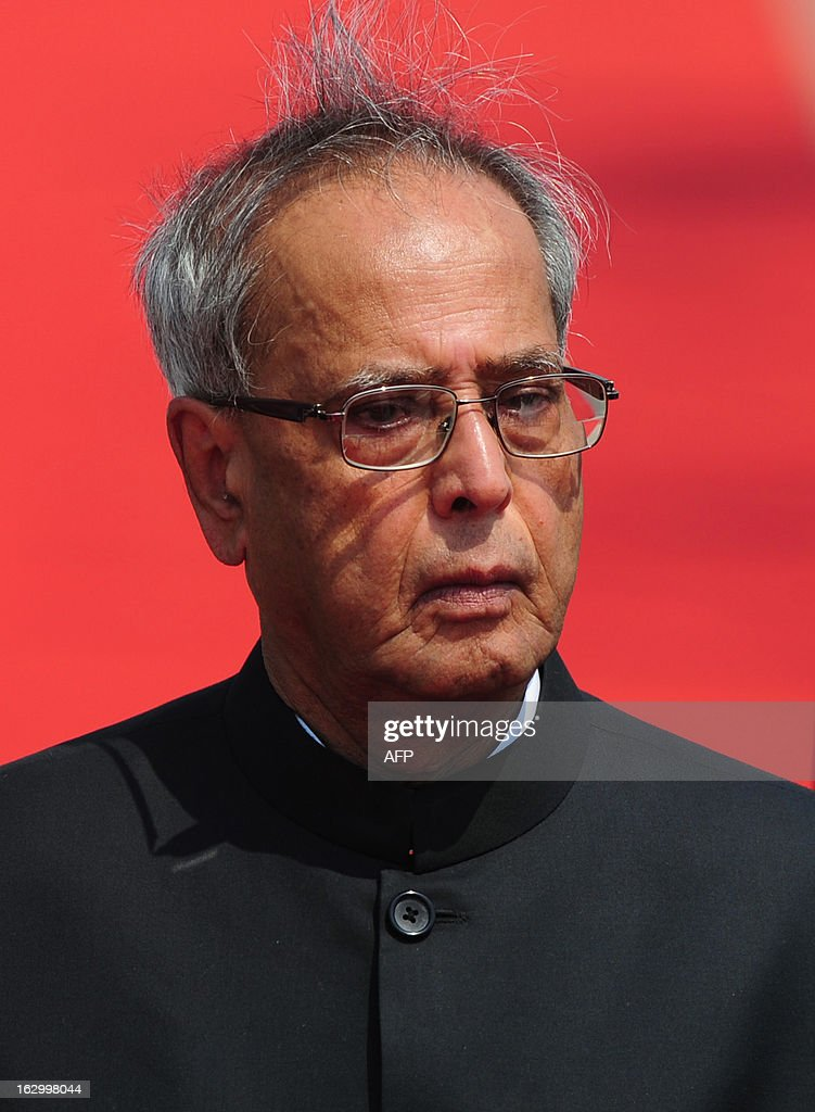 Indian President Pranab Mukherjee inspects a guard of honour after arriving at Hazrat Shahjalal International Airport in Dhaka on March 3, 2013, at the start of a state visit. Mukherjee is on a three-day state visit to Bangladesh until March 5. AFP PHOTO/Munir uz ZAMAN