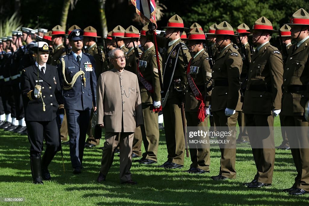 Indian President Pranab Mukherjee inspects the Guard of Honour after receiving an official Maori welcome or powhiri at Government House in Auckland on April 30, 2016. Mukherjee is in New Zealand for a three-day official visit. / AFP / MICHAEL