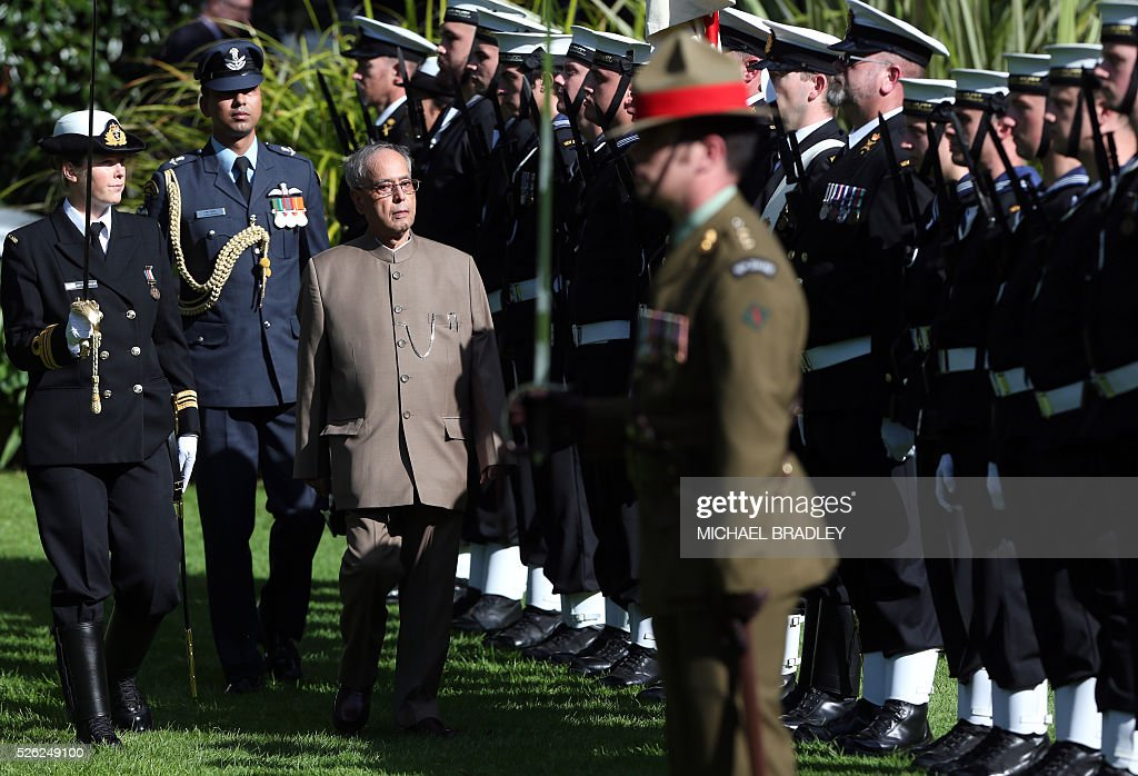 Indian President Pranab Mukherjee inspects the Guard of Honour during an official Maori welcome or powhiri at Government House in Auckland on April 30, 2016. Mukherjee is in New Zealand for a three-day official visit. / AFP / MICHAEL