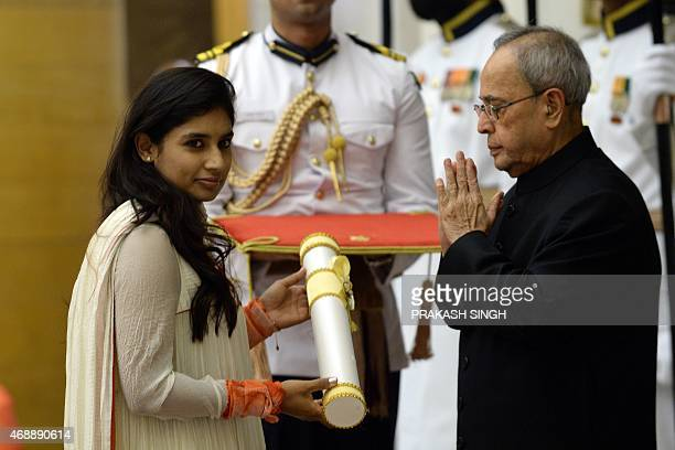 Indian President Pranab Mukherjee presents the Padma Shri Award to cricketer Mithali Raj during a Civil Investiture Ceremony at Rashtrapati Bhavan in...