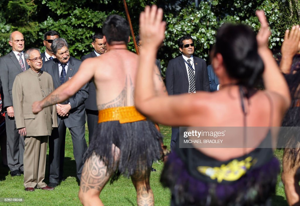 Indian President Pranab Mukherjee (2nd L) receives an official Maori welcome or powhiri with New Zealand Governor-General Lewis Moeau (3rd L) during a welcoming ceremony at Government House in Auckland on April 30, 2016. Mukherjee is in New Zealand for a three-day official visit. / AFP / MICHAEL