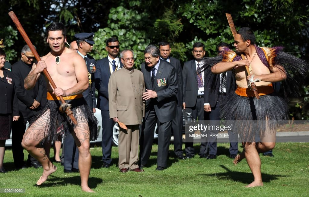 Indian President Pranab Mukherjee (centre L) receives an official Maori welcome or powhiri with New Zealand Governor-General Lewis Moeau (centre R) during a welcoming ceremony at Government House in Auckland on April 30, 2016. Mukherjee is in New Zealand for a three-day official visit. / AFP / MICHAEL