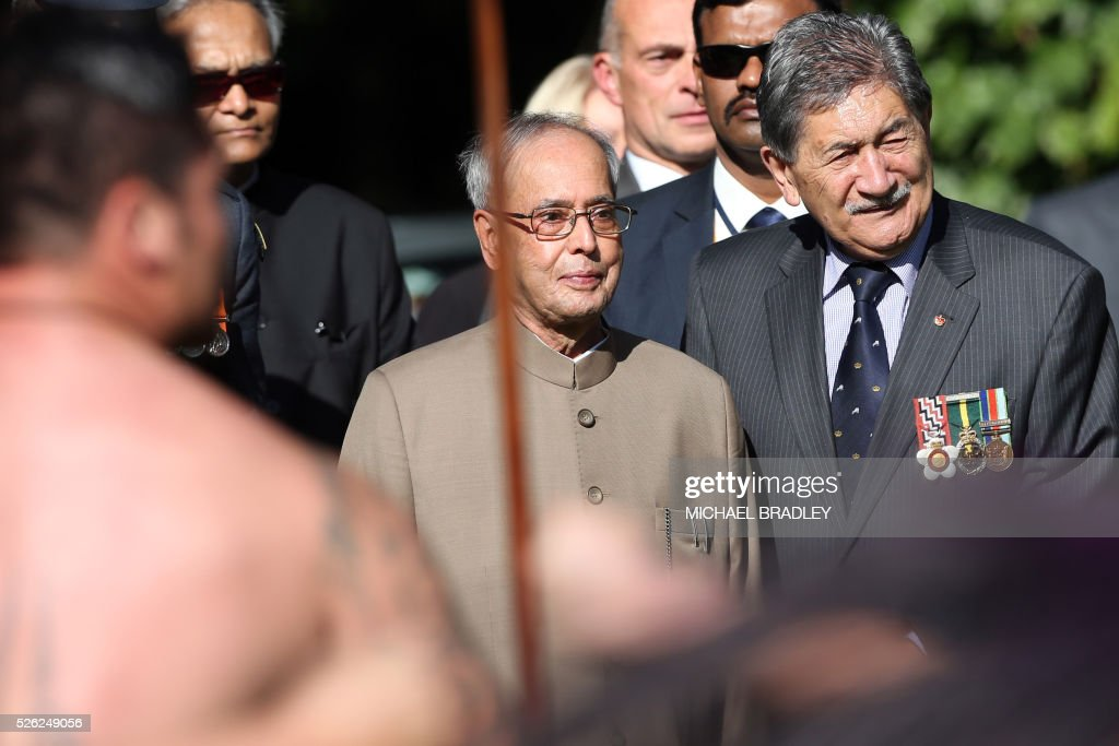 Indian President Pranab Mukherjee (C) receives an official Maori welcome or powhiri with New Zealand Governor-General Lewis Moeau (R) during a welcoming ceremony at Government House in Auckland on April 30, 2016. Mukherjee is in New Zealand for a three-day official visit. / AFP / MICHAEL