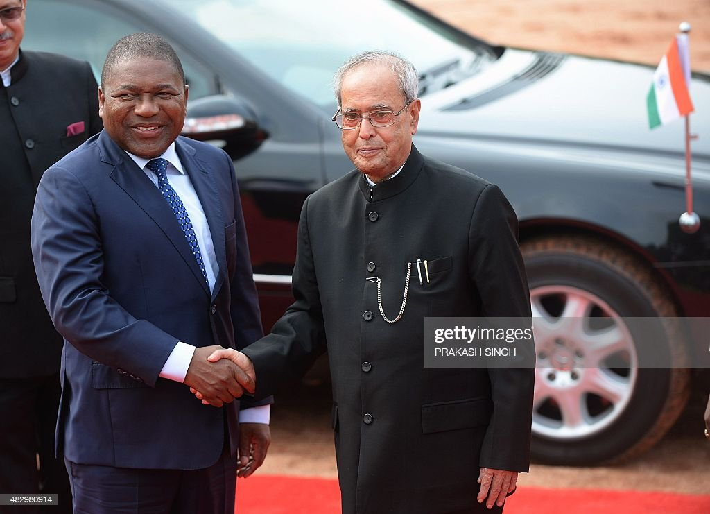 Indian President <a gi-track='captionPersonalityLinkClicked' href=/galleries/search?phrase=Pranab+Mukherjee&family=editorial&specificpeople=565924 ng-click='$event.stopPropagation()'>Pranab Mukherjee</a> (R) shakes hands with Mozambique President Filipe Jacinto Nyusi during a ceremonial reception at the presidential palace in New Delhi on August 5, 2015. Nyusi is the middle of a five-day state visit to India that ends August 8.