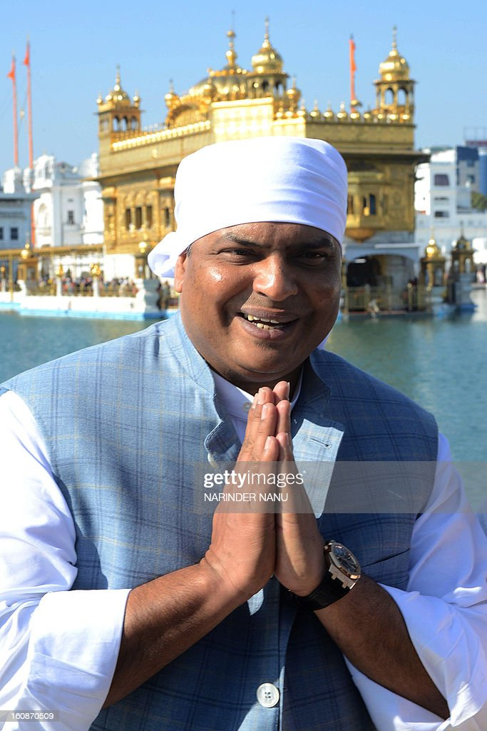 Indian President Pranab Mukherjee's son, Indrajit Mukherjee (C) gestures as he poses for a photo during a visit to the Golden Temple in Amritsar on February 7, 2013. Mukherjee along with his family members visited the city to attend a marriage function and also pay their respects at Sikh Shrine.