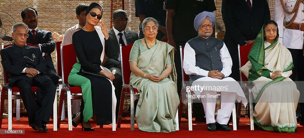 Indian President <a gi-track='captionPersonalityLinkClicked' href=/galleries/search?phrase=Pratibha+Patil&family=editorial&specificpeople=4335851 ng-click='$event.stopPropagation()'>Pratibha Patil</a>, Prime Minister <a gi-track='captionPersonalityLinkClicked' href=/galleries/search?phrase=Manmohan+Singh&family=editorial&specificpeople=227120 ng-click='$event.stopPropagation()'>Manmohan Singh</a> with his wife <a gi-track='captionPersonalityLinkClicked' href=/galleries/search?phrase=Gursharan+Kaur&family=editorial&specificpeople=767531 ng-click='$event.stopPropagation()'>Gursharan Kaur</a>, Al Thani's wife Sheikha Mozah bint Nasser Al Missned and Finance Minister Pranab Mukherjee take their seats during a Ceremonial Reception at Rashtrapati Bhawan on April 9, 2012 in New Delhi, India. During his stay in India, Sheikh Hamad will hold bilateral talks with Prime Minister <a gi-track='captionPersonalityLinkClicked' href=/galleries/search?phrase=Manmohan+Singh&family=editorial&specificpeople=227120 ng-click='$event.stopPropagation()'>Manmohan Singh</a>.