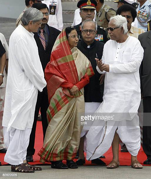 Indian President Pratibha Patil speaks with Buddhadev Bhattacharya the chief minister of West Bengal after her arrival as state governor Gopal...