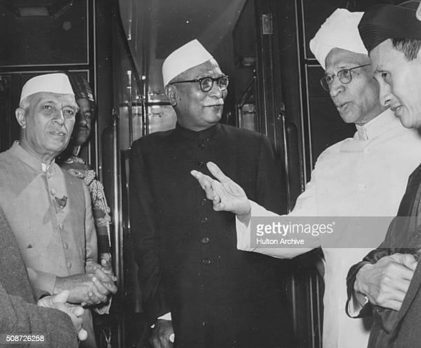 Indian President Rajendra Prasad talking to Dr Sarvepalli Radhakrishnan and Jawaharlal Nehru at the railway station in New Delhi March 13th 1959