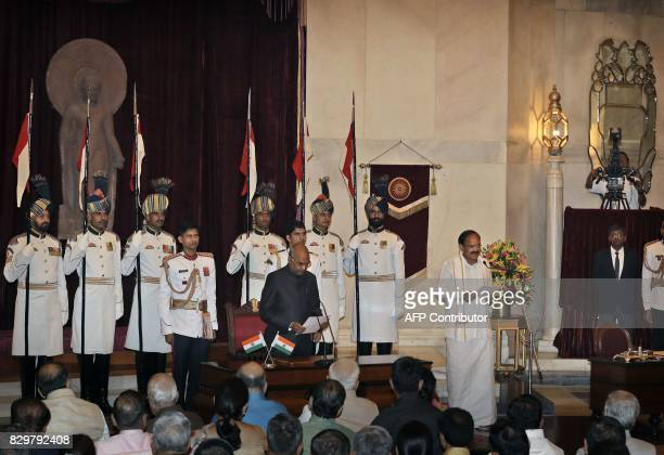 Indian President Ram Nath Kovind administers the oath of vice president to Venkaiah Naidu during his swearing in ceremony at the presidential palace...