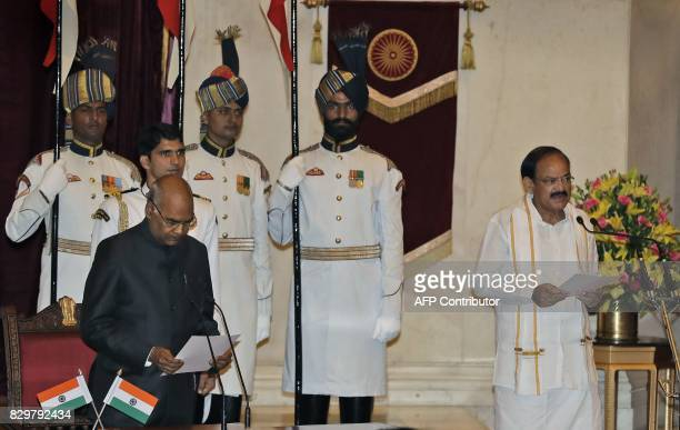 Indian President Ram Nath Kovind administers the oath of vice president to Venkaiah Naidu during a swearing in ceremony at the presidential palace in...
