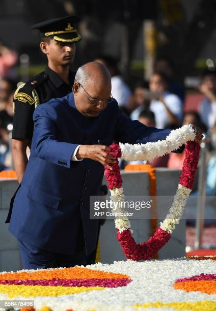 Indian President Ram Nath Kovind pays tribute on the 148th Birth Anniversary of Mahatma Gandhi at Rajghat in New Delhi on October 2 2017 / AFP PHOTO...