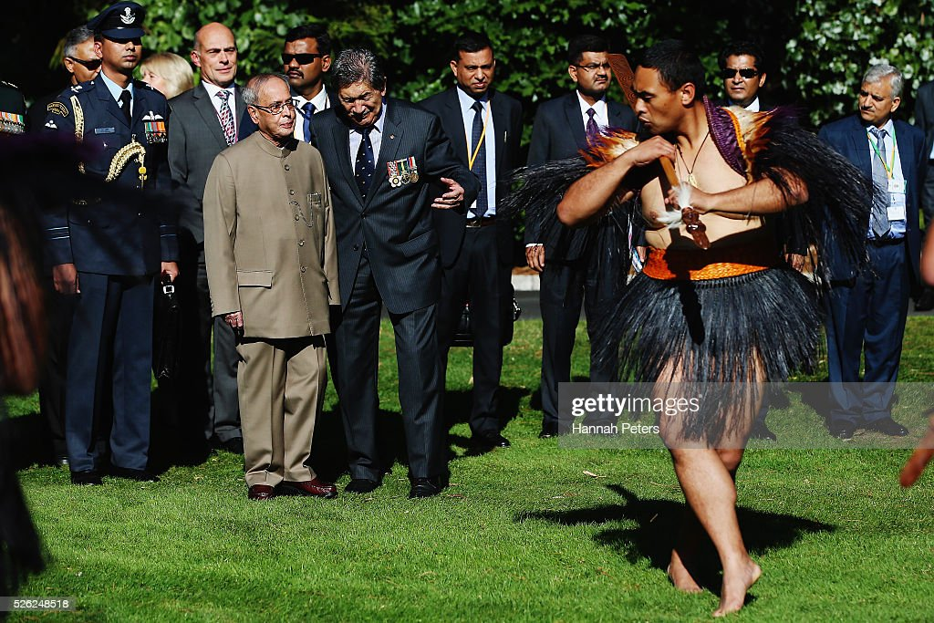 Indian President Shri <a gi-track='captionPersonalityLinkClicked' href=/galleries/search?phrase=Pranab+Mukherjee&family=editorial&specificpeople=565924 ng-click='$event.stopPropagation()'>Pranab Mukherjee</a> is challenged by a Maori warrior during a ceremony of welcome at Government House on April 30, 2016 in Auckland, New Zealand. It is the first time an Indian President has visited New Zealand.