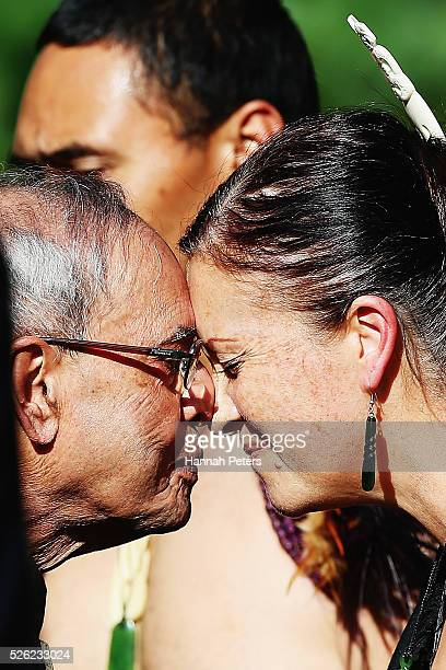 Indian President Shri Pranab Mukherjee receives a hongi from a Maori warrior during a ceremony of welcome at Government House on April 30 2016 in...