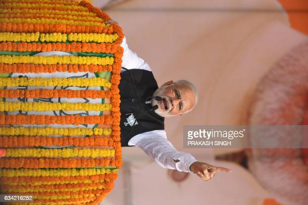 Indian Prime Minister and Bharatiya Janata Party leader Narendra Modi gestures as he addresses a state assembly election rally in Ghaziabad on...