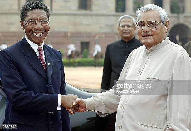 Indian Prime Minister Atal Behari Vajpayee greets Lesotho Prime Minister Bethuel Pakalitha Mosisili at the presidential palace in New Delhi 06 August...