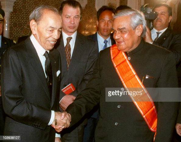 Indian Prime Minister Atal Behari Vajpayee is welcomed and decorated by Morocco's King Hassan Ii at the royal palace in Marrakesh 13 February...