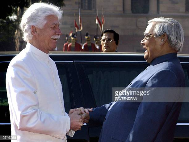 Indian Prime Minister Atal Behari Vajpayee shakes hands with Mauritius Prime Minister Paul Raymond Berenger the Presidential palace in New Delhi 21...