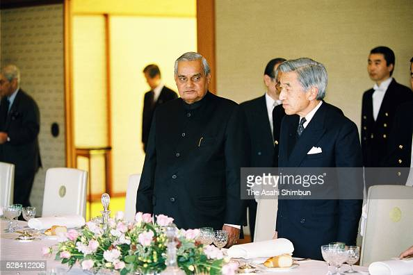 Indian Prime Minister Atal Bihari Vajpayee and Emperor Akihito attend the luncheon at the Imperial Palace on December 11 2001 in Tokyo Japan