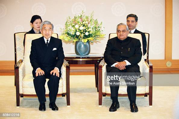 Indian Prime Minister Atal Bihari Vajpayee and Emperor Akihito pose for photographs during their meeting at the Imperial Palace on December 11 2001...
