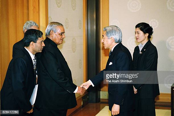 Indian Prime Minister Atal Bihari Vajpayee and Emperor Akihito shake hands prior to their meeting at the Imperial Palace on December 11 2001 in Tokyo...