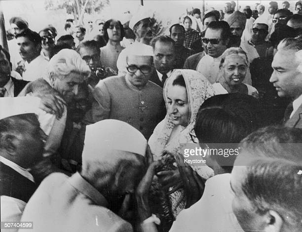 Indian Prime Minister Indira Gandhi is congratulated on her victory by crowds of people following a legal battle India November 14th 1975