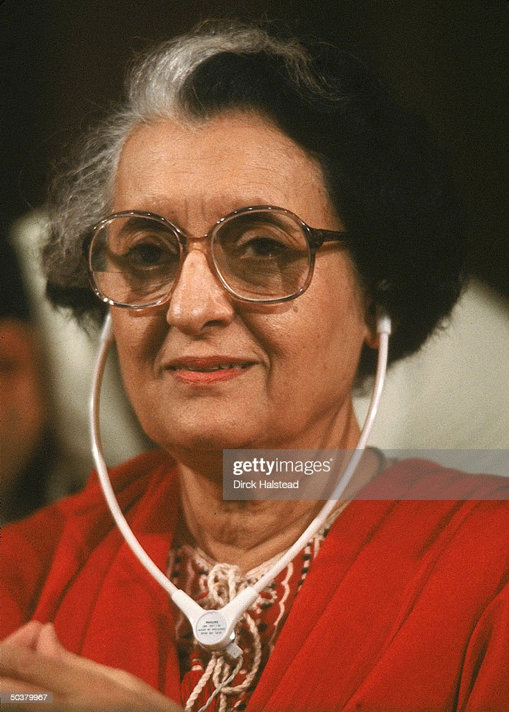 Indian Prime Minister Indira Gandhi wearing earphones at post NorthSouth Summit press conference