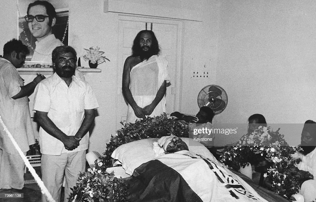 Indian Prime Minister Indira Gandhi's yogic mentor Dhirendra Brahmachari (1924 - 1994, centre) and others with the body of Gandhi's son, Indian politician Sanjay Gandhi (1946 - 1980) after his death in an air crash on 23rd June 1980.