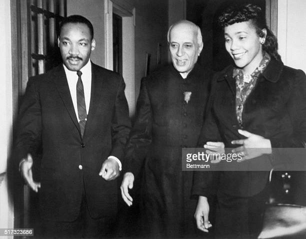 Indian Prime Minister Jawaharlal Nehru is flanked by his guests American civil rights leader Dr Martin Luther King and wife Coretta Scott King during...