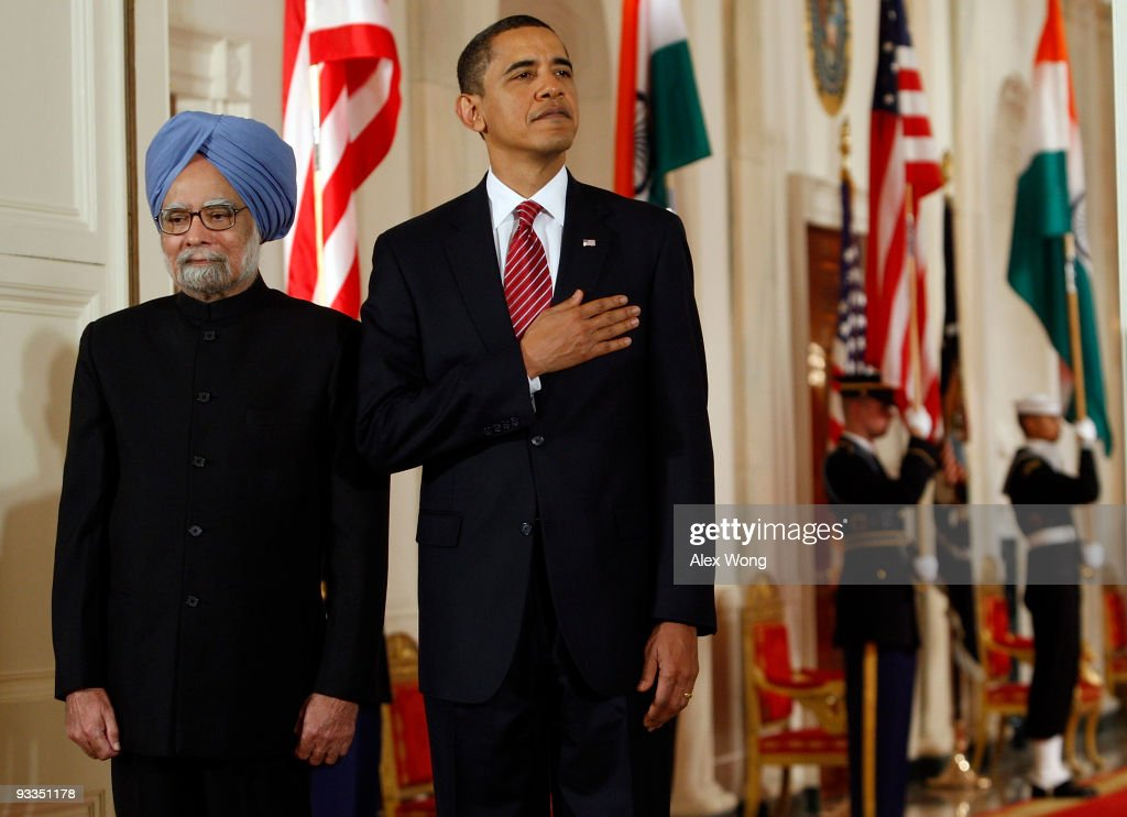 Indian Prime Minister <a gi-track='captionPersonalityLinkClicked' href=/galleries/search?phrase=Manmohan+Singh&family=editorial&specificpeople=227120 ng-click='$event.stopPropagation()'>Manmohan Singh</a> (L), accompanied by U.S. President <a gi-track='captionPersonalityLinkClicked' href=/galleries/search?phrase=Barack+Obama&family=editorial&specificpeople=203260 ng-click='$event.stopPropagation()'>Barack Obama</a> (R), listens to the American national anthem as they participate in a state arrival ceremony in the East Room of the White House November 24, 2009 in Washington, DC. President Obama hosted Prime Minister Singh in the administration�s first state visit with an Oval Office meeting, a joint news conference and a state dinner.