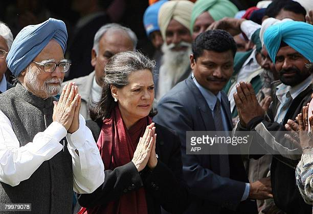 Indian Prime Minister Manmohan Singh and Congress Party President and UPA Chairperson Sonia Gandhi are greeted by farmers in New Delhi on February 25...
