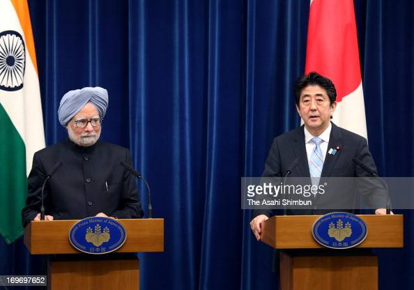 Indian Prime Minister Manmohan Singh and Japanese Prime Minister Shinzo Abe attend the joint press conference after their summit meeting at Abe's...