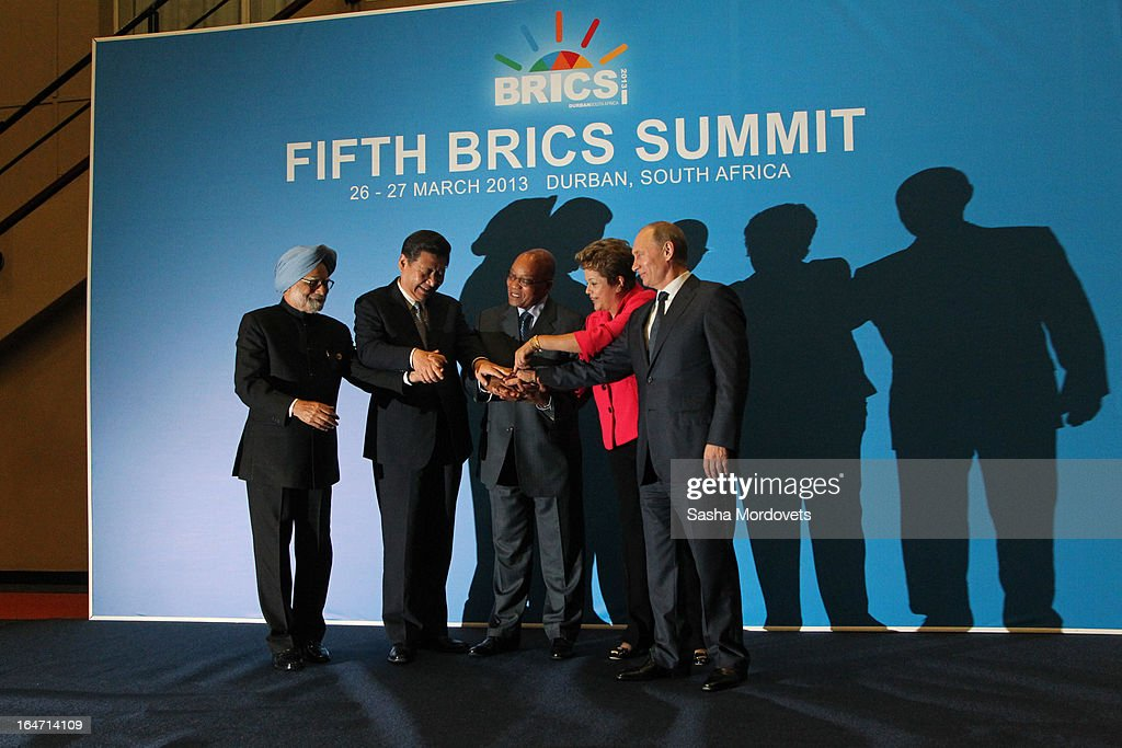 Indian Prime Minister Manmohan Singh, Chinese President Xi Jinping, South Africa President Jacob Zuma, Brazil's President Dilma Rousseff and Russian President Vladimir Putin pose for photographers during the BRICS Summit on March, 27,2013 in Durban, South Africa. In the fifth summit of the BRICS nations leaders, they talked about forming a development bank to aid developing nations.