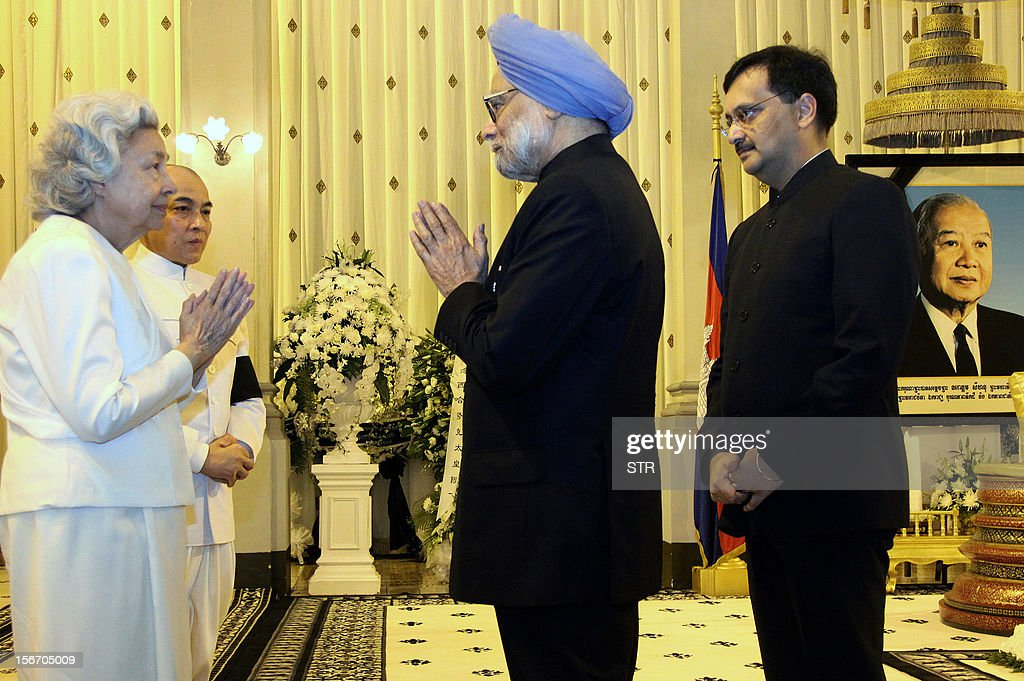 Indian Prime Minister Manmohan Singh (C) condoles the late former Cambodian King Norodom Sihanouk's widow Queen Monique (L) while King Norodom Sihamoni (2L) looks on after the Indian leader paid his respects at the coffin of the late former King Norodom Sihanouk at the Royal Palace in Phnom Penh on November 19, 2012. Manmohan Singh is in Phnom Penh for the East Asia Summit in the Cambodian capital where the 10 leaders of the Association of Southeast Asian (ASEAN) are gathered for the 21st ASEAN Summit.