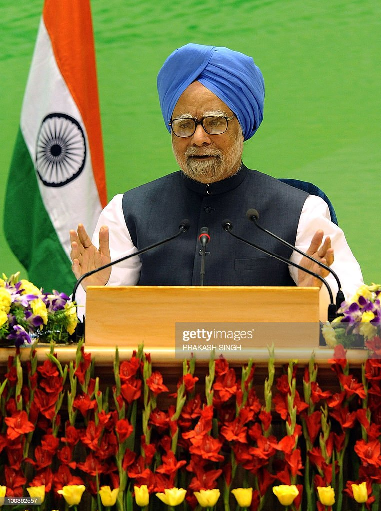 Indian Prime Minister Manmohan Singh gestures while speaking at a press conference in New Delhi on May 24, 2010. Singh said that a cross-border 'trust deficit' was the main obstacle holding back any improvement in relations between India and arch-rival Pakistan. AFP PHOTO/ Prakash SINGH