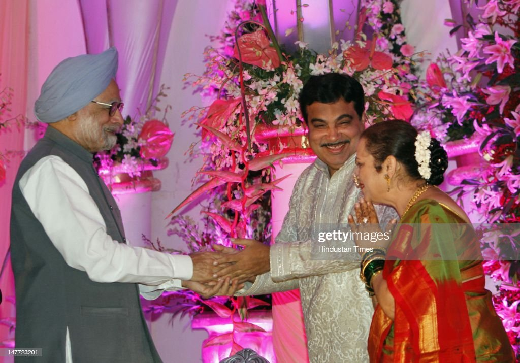 Indian Prime Minister <a gi-track='captionPersonalityLinkClicked' href=/galleries/search?phrase=Manmohan+Singh&family=editorial&specificpeople=227120 ng-click='$event.stopPropagation()'>Manmohan Singh</a> greets BJP presdent Nitin Gadkari and his wife Kanchan Gadkari during a wedding reception of Gadkar's son Sarang Gadkari's on July 2, 2012 in New Delhi, India. Nitin Gadakari's younger son Sarang tied knot with his classmate Madhura on June 24, 2012 in Nagpur.