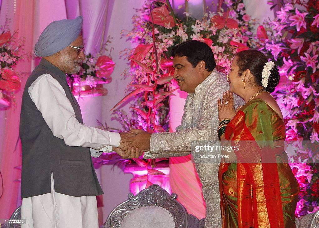 Indian Prime Minister Manmohan Singh greets BJP presdent Nitin Gadkari and his wife Kanchan Gadkari during wedding reception of Gadkar's son Sarang Gadkari's on July 2, 2012 in New Delhi, India. Nitin Gadakari's younger son Sarang tied knot with his classmate Madhura on June 24, 2012 in Nagpur.