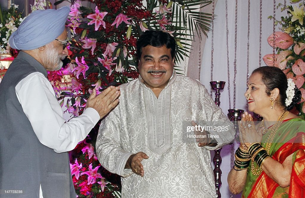 Indian Prime Minister Manmohan Singh greets BJP presdent Nitin Gadkari and his wife Kanchan Gadkari during wedding reception of Gadkari's son Sarang Gadkari's on July 2, 2012 in New Delhi, India. Nitin Gadakari's younger son Sarang tied knot with his classmate Madhura on June 24, 2012 in Nagpur.