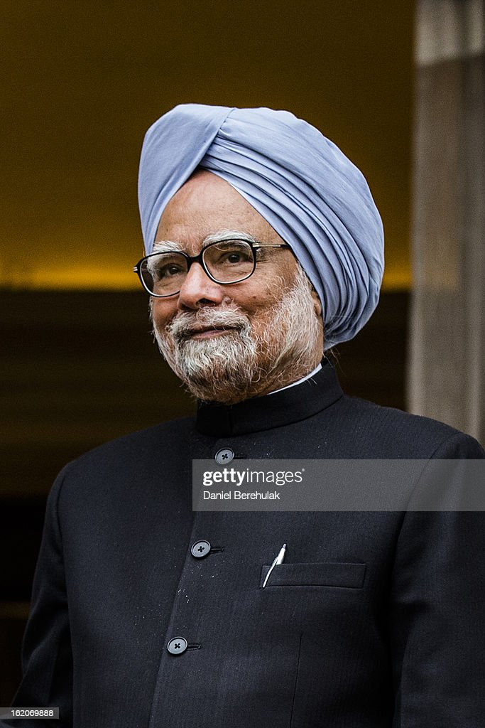 Indian Prime Minister <a gi-track='captionPersonalityLinkClicked' href=/galleries/search?phrase=Manmohan+Singh&family=editorial&specificpeople=227120 ng-click='$event.stopPropagation()'>Manmohan Singh</a> looks on at Hyderabad House on February 19, 2013 in New Delhi, India. British Prime Minister David Cameron arrived in India on Monday for an official three-day trip accompanied by a large business delegation from the UK.