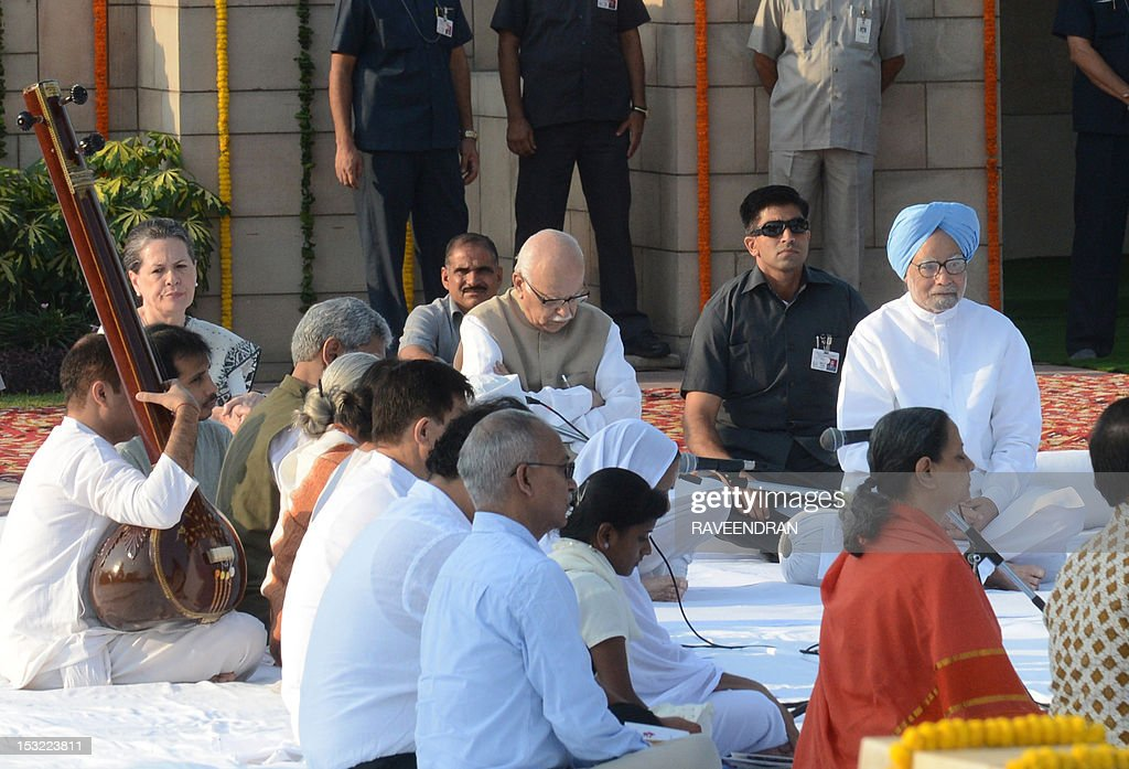 Indian Prime Minister Manmohan Singh (R), senior leader of India's main opposition Bharatiya Janata Party (BJP) Lal Krishna Advani (C) and Congress party president Sonia Gandhi (L) sit as they pay their respects at the memorial to the Father of the Nation Mahatma Gandhi at Rajghat in New Delhi on October 2, 2012, in honour of Gandhi's 143rd birth anniversary. Indians all over the country are celebrating the founding father's birthday with prayers and social activities as a mark of respect to Gandhi, famed as the torchbearer of India's fight against British rule. AFP PHOTO/RAVEENDRAN