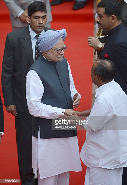 Indian Prime Minister Manmohan Singh shakes hands with Indian Defence Minister AK Antony after delivering his speech from the ramparts of The Red...
