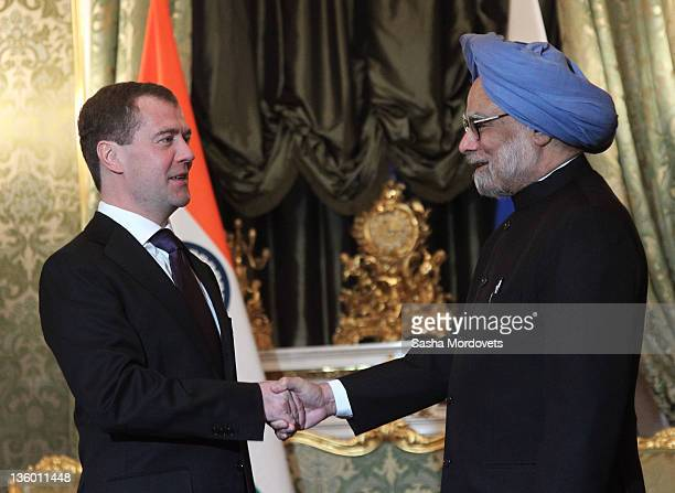 Indian Prime Minister Manmohan Singh shakes hands with Russian President Dmitry Medvedev during their meeting at the Kremlin December 2011 in Moscow...